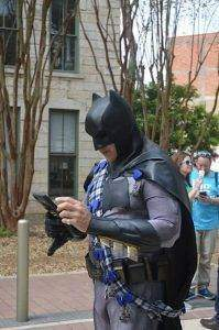 Batman checking his phone during Big Give Pep Rally