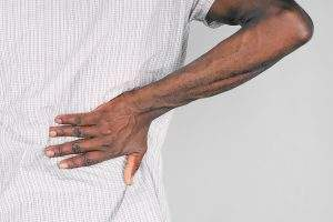 African American Male Grabbing Back for Kidney Pain